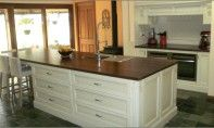 Traditional hand painted French provincial kitchen with timber island benchtop