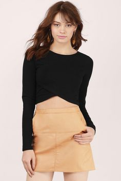 Show your edgy side with the Rough Around The Edges Crop Top. Long sleeved crop top with an angled hem and layered front. Wear with high waisted denim or dress it up with a skirt and heels.
