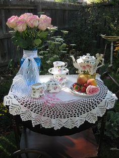 Tea time on the hand crochet table cloth.