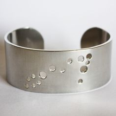 This aluminum constellation cuff bracelet is a subtle reminder that you were born from bursts of stardust! Perfect for the star gazer in you. Whether this is your sign, or that of a loved one, this Pisces zodiac constellation cuff is a constant yet gentle affirmation of all that is a Pisces: intuitive, dreamy, and sensitive.