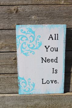 All you need is love wooden sign by TwinseyWhimsy on Etsy, $20.00