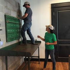 Here's @chippergaines and @joannagaines hanging fixtures in Chip's corner of the Market at the Silos! Chip will have his own section of the store featuring some of his favorite products - can't wait for y'all to see!