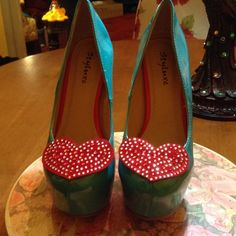 Turquoise heels with crystal heart Never worn turquoise platforms with red crystal heart appliqué .  So fab! Fits more like a 7-7.5. Styluxe Shoes Platforms