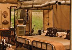 """I'm not really a """"modern safari"""" person, but this new mobile camp by Singita is pretty interesting from a design perspective. Crafted from canvas tents and old-school furnishings that seem like they came straight from the set of """"Out of Africa,"""" this is a Luxury Tents, Luxury Camping, Bungalow, Tent Living, Outdoor Living, Living Spaces, Vintage Safari, Camping Aesthetic, Adventure Aesthetic"""