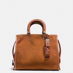 Coach Rogue Bag ($795) ❤ liked on Polyvore featuring bags, handbags, shoulder bags, pocket purse, suede shoulder bag, coach shoulder bag, coach purses and suede purse