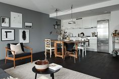Black floors, grey walls and lots of art pieces - via cocolapinedesign.com