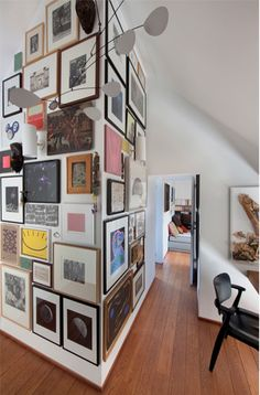 "You might think ""ah! clutter!"" but my mind goes: ""yyeesssss."" Framed art collage, floor to ceiling!"