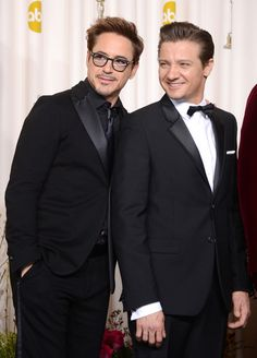 Presenters Robert Downey Jr. (L) and Jeremy Renner pose in the press room during the Oscars held at Loews Hollywood Hotel on February 24, 2013 in Hollywood, California.