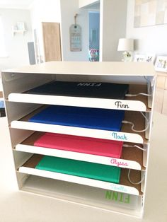 iPad Charging Station using Ikea Kvissle Letter Tray. Vinyl name labels from Pretty Paper Label.
