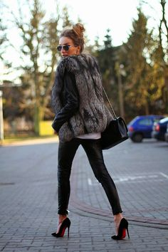 Sophisticated look: fur vest, leather pants, and black Louboutin high heels