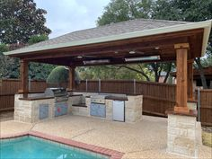 Groudscape built this outdoor kitchen along with the outdoor patio Landscaping Company, Landscaping Ideas, Flower Bed Edging, Patio Grill, Deck Makeover, Drainage Solutions, Landscape Services, Stained Concrete, Outdoor Living Areas