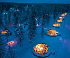 Kakslauttanen hotel in Lapland allows people to admire the beauty of the northern lights in the comfort of warm and secure glass igloos.  Large windows are constructed out of special thermal glass that does not freeze. Every igloo is equipped with small bathroom and two beds.