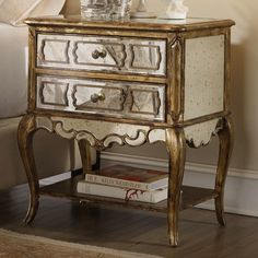 Features:  -One shelf.  -Mirrored leg nightstand.  -Felt lined top drawer.  Frame Material: -Manufactured wood/Wood.  Top Material: -Manufactured wood/Mirror/Wood.  Finish: -Bling.  Top Finish: -Antiq