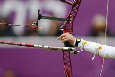 London 2012 - A competitor releases her arrow in the women's Team Archery contest at Lord's Cricket Ground Day 2 (Jully 29). .....Olympics 2012- London, England