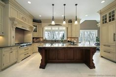 #Kitchen of the Week: A luxury home with antique white cabinets, ornate details, a wood hood, and a dark cherry island. Kitchen # 9 in the Traditional Two-Tone Kitchens Gallery
