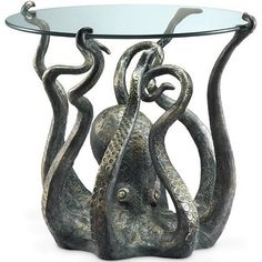 Add a showpiece furnishing accent to your coastal décor with our undersea Denizen Of The Deep table. Cast in durable aluminum, it features eight delicately curling tendrils supporting a sturdy round glass top. Whatever you place on it - an exotic sea urchin lamp; a stack of beautiful sea life photography books; your favorite seashells - will be beautifully showcased by this extraordinary table. Table measures 25.5 wide x 22.5 tall. 2-week delivery.