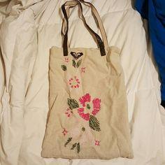 Roxy mini tote Small tan roxy tote with flowers. Little wear on straps Roxy Bags Mini Bags