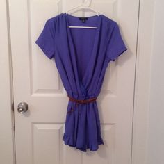 UK2LA Deep V romper Size M. Lavender blue. Cognac braided belt that can be taken off ( held through attached loops). Bottom short portion of romper is lined and has ruffles at bottom of shorts. Elastic waistband. 100% polyester and in excellent condition! So cute for summer. Feel free to ask me any questions😊 UK2LA Dresses