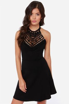 Lace In the Right Place Black Halter Dress: This dress has all the signs of a great design, with a beautiful crocheted lace panel topping a halter neck bodice. Adjustable ties support the sheer, Boho-friendly lace, partnered with a fitted bodice and full skirt made of thick stretch knit. Hidden back zipper. Unlined. Hand wash cold $40