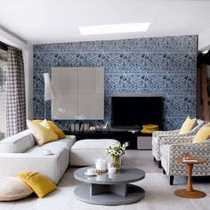 Eclectic living room with stylish wallpapers