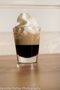 Here is the recipe for a Blow Job:      3/4 oz Kahlua     3/4 oz Baileys     whipped cream   In a shot glass, pour in your Kahlua first and then layer your Baileys on top.