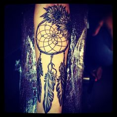 Latisha wood did this beautiful custom dream catcher with sun flowers on my forearm! I love it:)