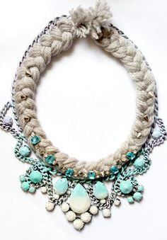 Beautiful gunmetal plated chain that ombres from lilac to a soft turquoise to a cream white.Embellished with silver cone spikes and aqua blue crystal stones.Each necklace is handmade, not everyone look exactly the same but will be very similar. This necklace measures 18 inches.Item will ship 1-2 weeks depending on supplies that are in stock.