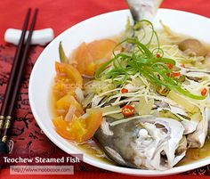 Steamed fish the teochew way - using a whole fish, and with salted vegetables and salted plums