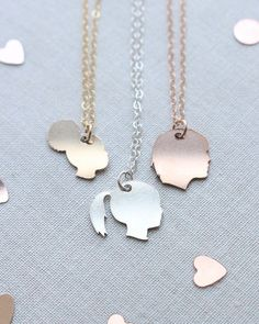 Rose gold, silver or gold Custom Silhouette Necklace by Olive Yew. Wear a surprisingly detailed custom silhouette necklace of your child, grandchild, pet, or any other person you want to keep close to your heart.