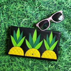 """Kate Spade Wing It Pineapple Tally Clutch A summer staple... or year- round, for us pina fans! Gorgeous, NWT Kate Spade Wing It Tally leather clutch with 3 adorable pineapple applicques decorating the front. Flip top w/ magnet closure, 6 credit card slots and interior zip pocket. Approx. 10"""" in length, 6"""" in height and 1"""" wide. Ships w/ Kate Spade dust bag. kate spade Bags Clutches & Wristlets"""