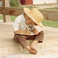 Amish boy writing