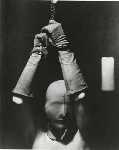 Woman in Mask and handcuffs.   Man Ray 1928.