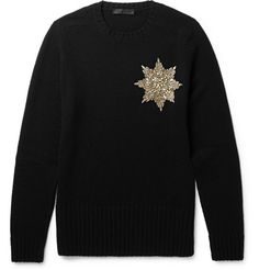 Alexander McQueen Embellished Shetland Wool Sweater. The centenary of World War I was the inspiration for the latest Alexander McQueen collection, and the gold-tone star on this Shetland wool sweater resembles the pendant of a service medal. The motif has been artfully picked out with metallic beads and iridescent gemstones, lending it an eye-catching appearance.