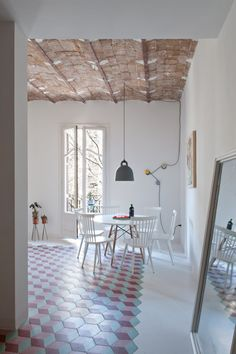 Renovated Barcelona apartment features vaulted brick ceilings and colourful floor tiles