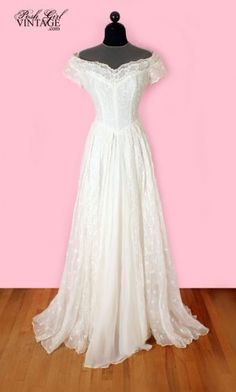 1950's White Organdy Long Vintage Wedding Dress -M:   This is an amazing 50's vintage wedding dress made of white embroidered organdy. Long full 3 layered skirt. Inside liner is white rayon, middle layer is sheer organdy, them embroidered top layer. Buttons in the back, ultra sheer on the top of the neck & chest area. It's too big for our size 3/4 mannequin so the fit in the photos is not the best. The color is white, not yellowed or off white. {Sold}