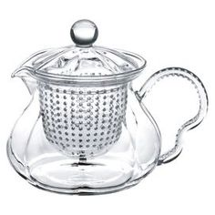 "Indulge your favorite tea lover with this alluring essential, perfect for elegant Sunday brunches or as a Mother's Day gift.      Product: Teapot    Construction Material: Glass    Color: Clear   Features:   Comes with a removable glass strainer   Specially designed non-dripping feature   Crystal clear high quality glass allows tea lovers to watch each bloom unfolding   Can also be used to brew loose leaves, iced tea or used as a pitcher 20 Ounce capacity     Dimensions: 5.25"" H x 5""…"