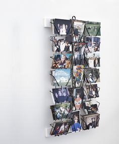 Keep your photos from monopolizing space all over the house with a postcard display rack that doubles as storage.