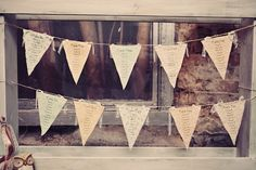 Write seating assignments on fabric bunting for a whimsical seating chart! {Renaissance Studios Photography}
