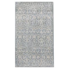 Anchor your dining set or living room seating group with this hand-tufted wool rug, showcasing a damask-inspired motif in light blue.   ...