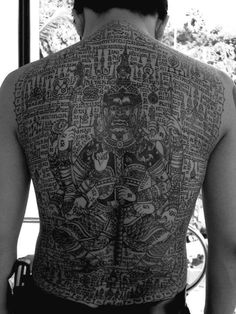If you are going for a Thai tattoo design that also has some script on it, then get it translated and find out what it means before you include it in your tattoo design. Yantra Tattoo, Sak Yant Tattoo, Badass Tattoos, Body Art Tattoos, Tatoos, Sak Yant Tiger, Tatoo Thai, Traditional Thai Tattoo, Atlas Tattoo