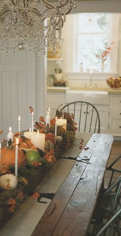 Fall table, I also love the fancy chandelier with the rustic table