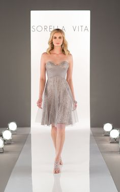 Stunning sequin takes a romantic turn with this bridesmaid dress. A criss-cross tulle bodice cascades into a gorgeous cocktail-length skirt overlay.