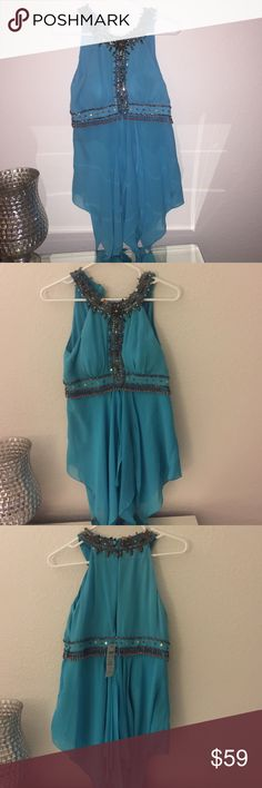 Cache teal embellished shirt.  Never worn Cache embellished top.   All the stones in place.    Cache Tops Blouses