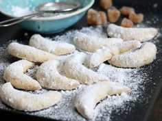 Variation of the classic German Vanillekipferl (vanilla crescent cookie) - spicy and sweet ginger bring a lot of flavor to this traditional bake! Crescent Cookies, Baking Parchment, Confectioners Sugar, Baking Sheet, Christmas Cookies, Roots, Biscuits, Cinnamon, Vanilla