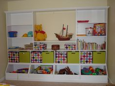 Built ins for playroom.  We used Ana White plans for bottom and designed the top shelves ourselves.  Built for around 300