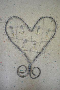 Muistilapputeline seinälle rautalangasta