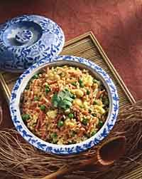 Chinese-style brown fried rice.  I made this for dinner tonight!  We added our own veggies and sesame seeds, yum!