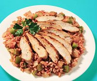 Cajun Chicken with Dirty Rice  INGREDIENTS  1 teaspoon dried Cajun seasoning  4 ounces chicken breast  2 teaspoons olive oil  2 garlic cloves, minced  1 cup chopped onion  1 green bell pepper, diced  2 tablespoons tomato paste  3/4 cup precooked brown rice  few dashes Tabasco sauce, to taste