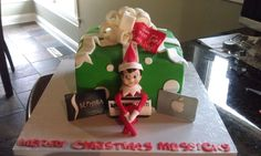 Elf on a Shelf cake - WASC cake covered in fondant with fondant elf, gift cards and bow.  Merry Christmas!!