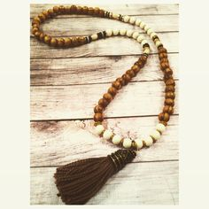 Boho Wood Beaded Tassel Necklace  by SomeLikeItCharmed on Etsy